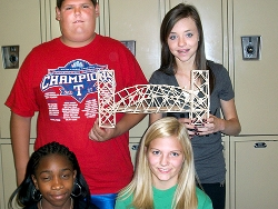 Donna Hunt's students show off their prized toothpick bridge.