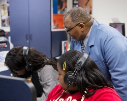 "Facilitator Charles Richardson regularly reminds his STEM lab students, ""You're getting to use your brain, your hands, your ears, your eyes for your own benefit."""