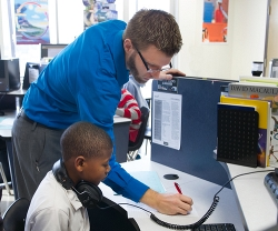 Facilitator Nicholas Keith is never more than a few feet away when students in his Pitsco lab have a question or need assistance.